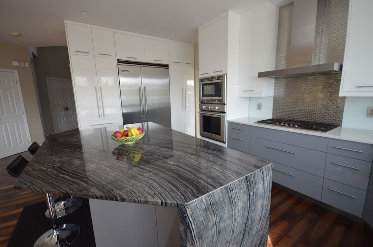Kitchen Perimeter Material - Stellar Snow Silestone Quartz 3CM with an Eased edge / Kitchen Island Material - Silver Snake Quartzite with an Eased, Two-Sided Waterfall edge