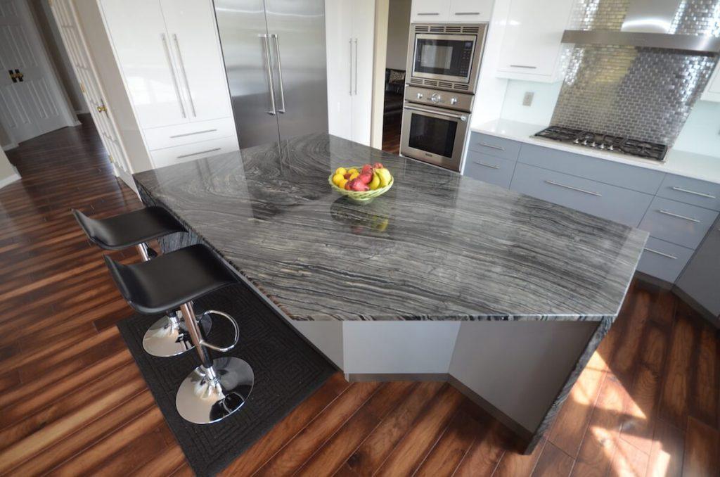 Kitchen Perimeter Material - Stellar Snow Silestone Quartz 3CM with an Eased edge / Kitchen Island Material - Silver Snake Quartzite with an Eased, Two-Sided Waterfall edge