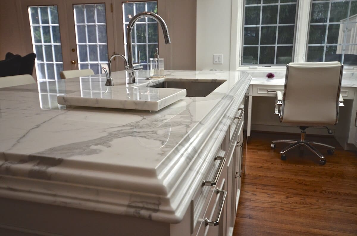 Kitchen Island - Calacatta Borgi Marble with a Double Laminated Ogee over Cove Dupont.