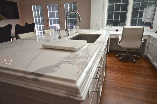 Kitchen Island Calacatta Borgi Marble with a Double Laminated Ogee over Cove Dupont.