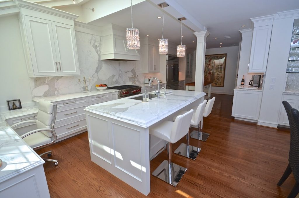 Kitchen Perimeter Material - Calacatta Gold Extra Marble with a Cove Dupont Edge / Kitchen Island & Backsplash Calacatta Borgi Marble with a Double Laminated Ogee over Cove Dupont.