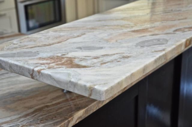 Kitchen Island Material - Blue Fantasy Marble Leathered with Eased, Two-Sided Waterfall Edge